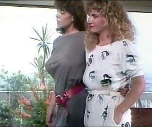 Christy Canyon watches Rikki..